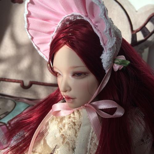Eden in bonnet close up