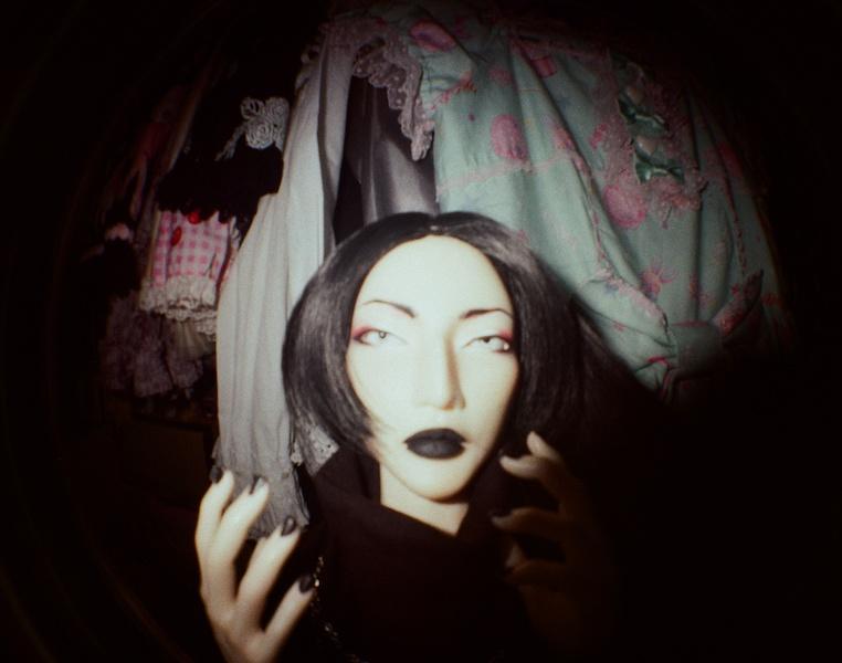 KYM fisheye in front of wardrobe