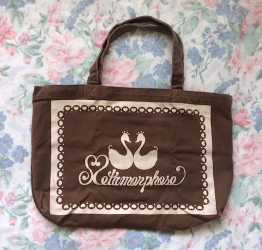 brown and cream logo tote bag