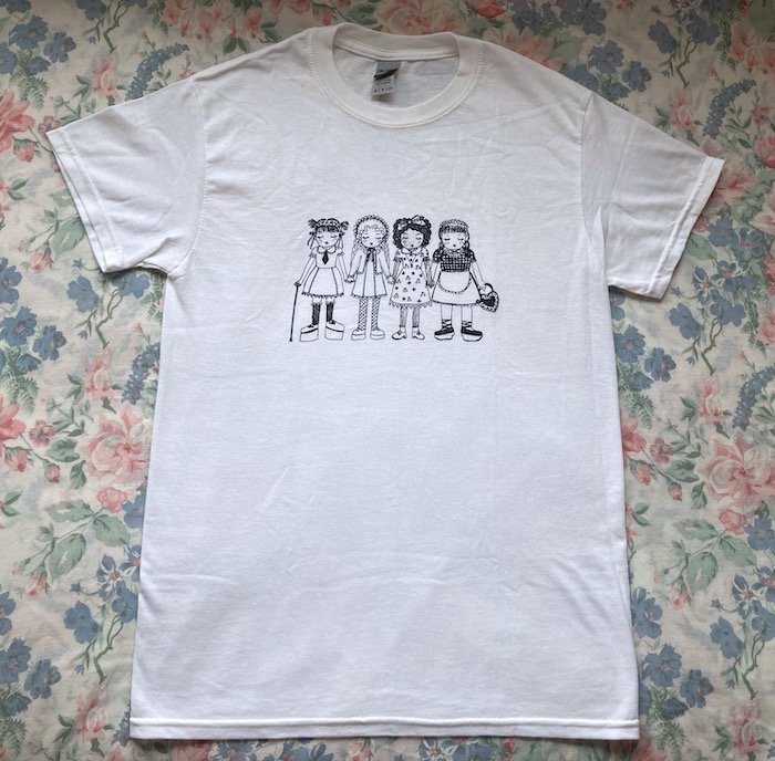 white t shirt with 4 girls holding hands