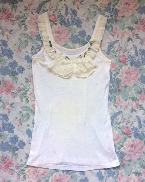 cream sleevless top with neck frill