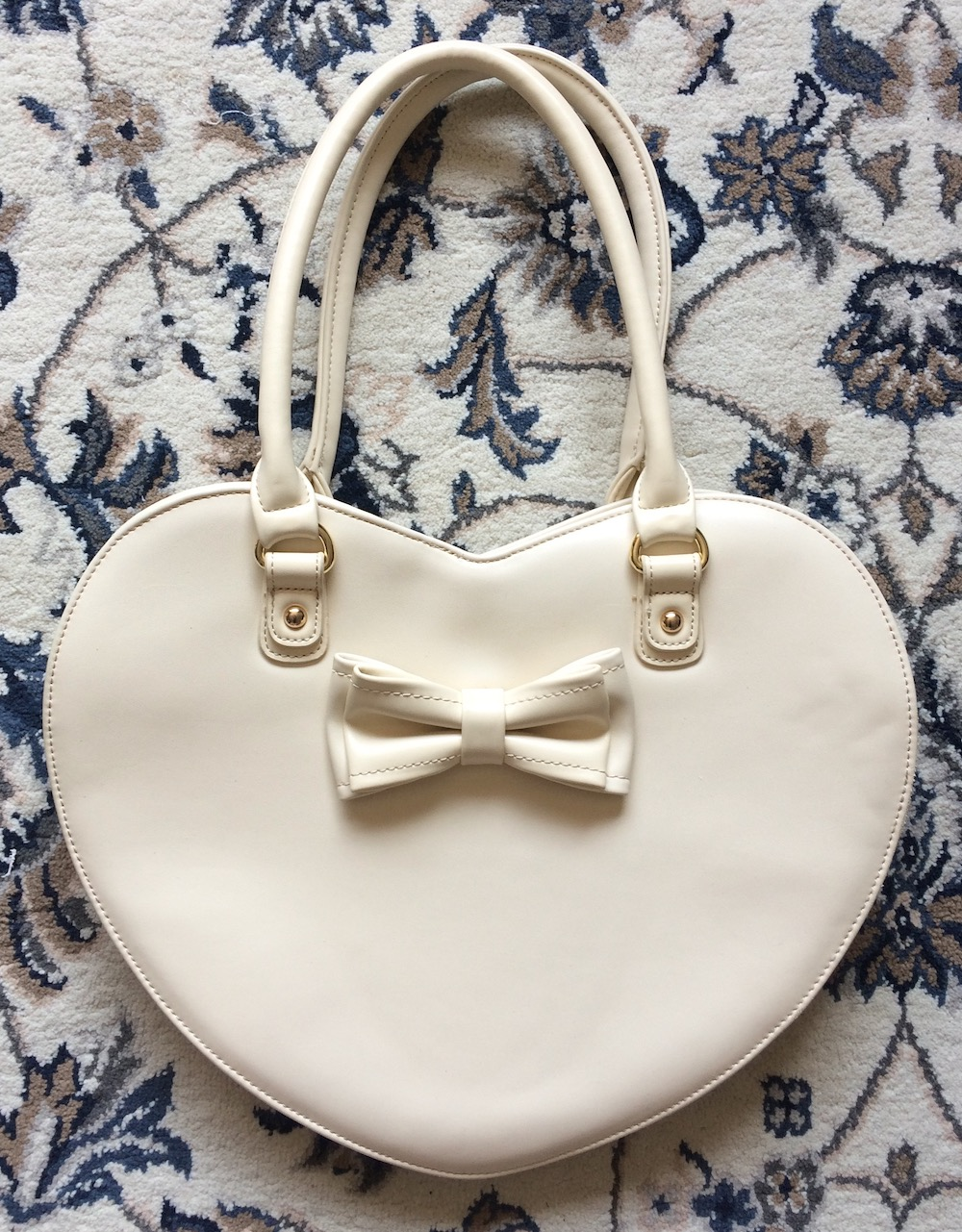 cream heart bag