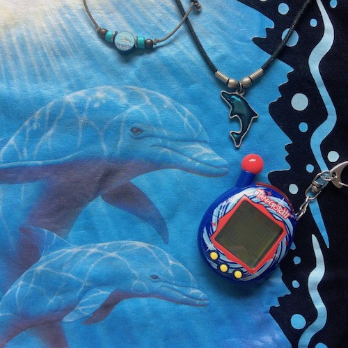 black and blue accessories and details with dolphins