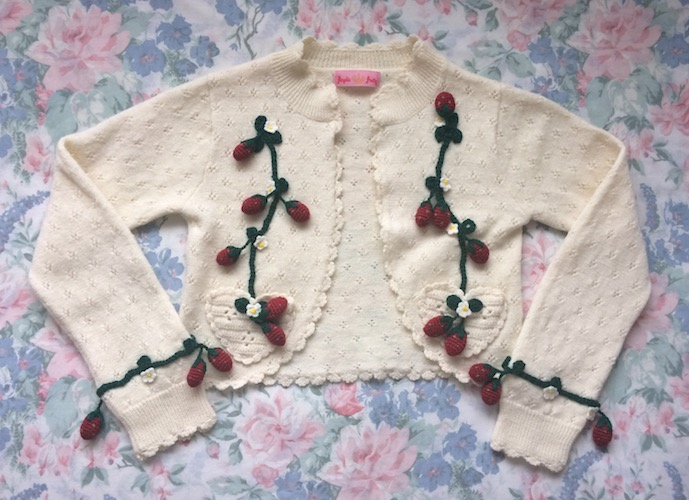 white cardigan with strawberries